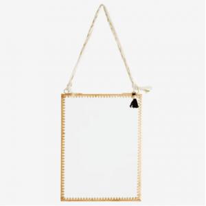 Miroir suspendu avec détail doré